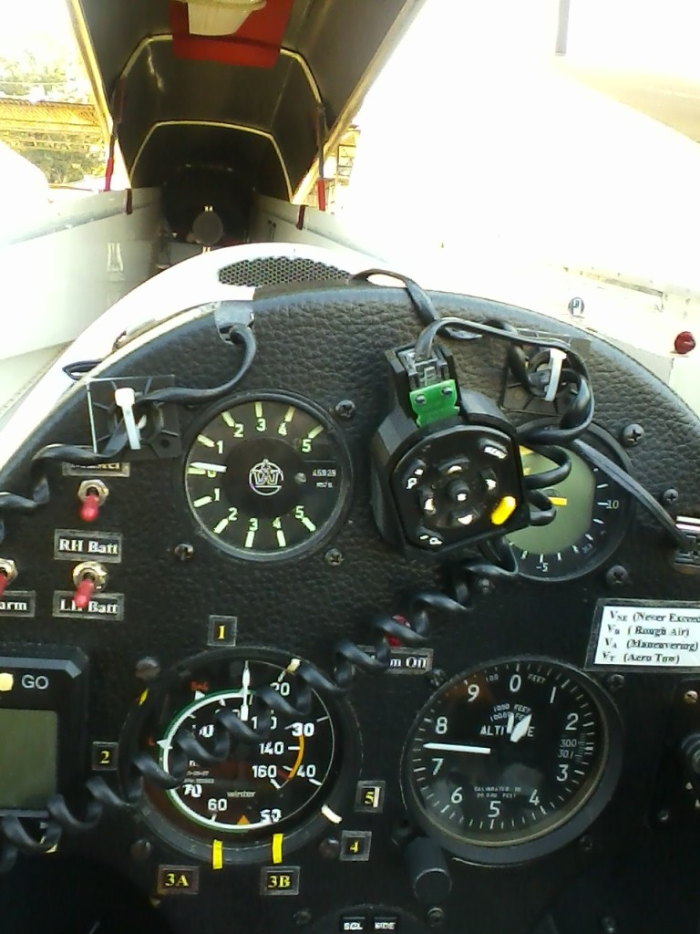 Remote caddy detached from flap grip and connected to 'garage' piece mounted to instrument panel using one of the instrument screws