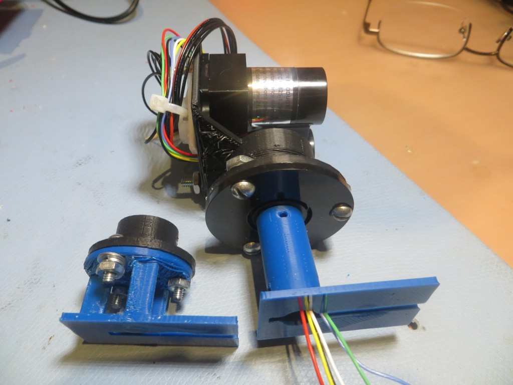 Original  and 2nd versions of the LIDAR slip ring assembly mount