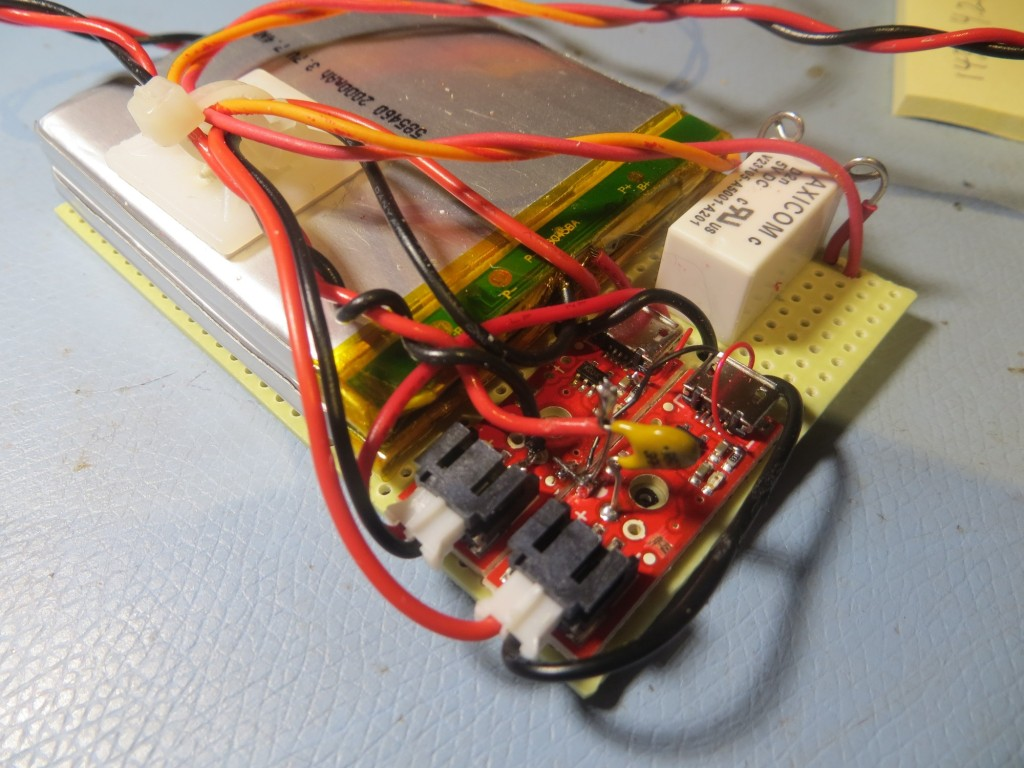 Battery pack showing charging modules and switching relay. The tan capacitor-looking component is actually a re-settable fuse