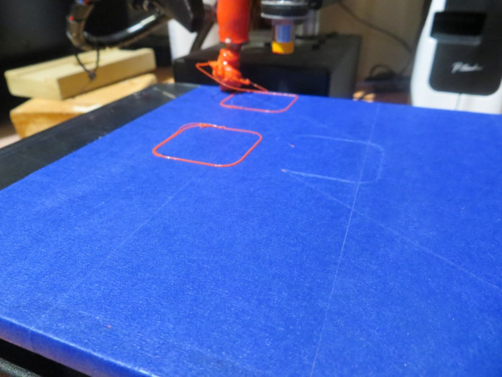 First try at printing 20mm cal cube at the third position (0,53). Note the blob attached to the extruder!