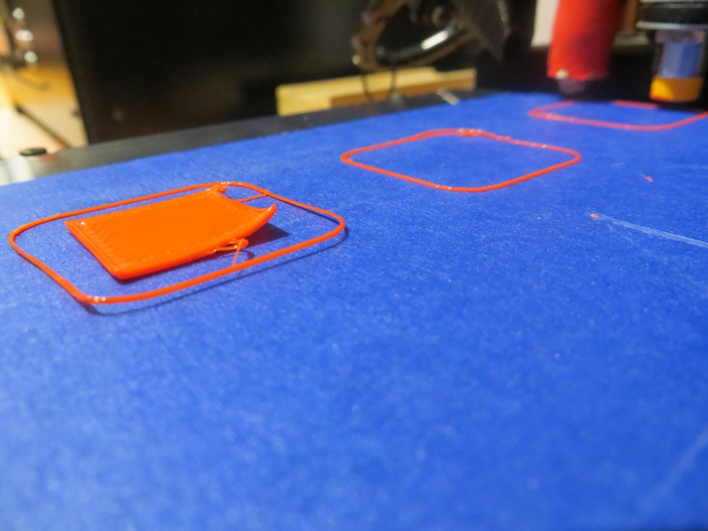 2nd try at printing 20mm cal cube at the third position (0,53). Note the raised corner